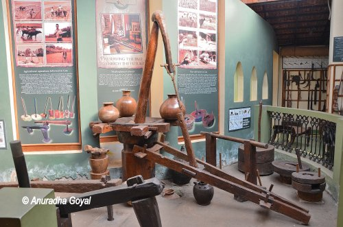 Traditional equipment for Extracting Oil from Dried Coconuts on display at Goa Chitra Museum