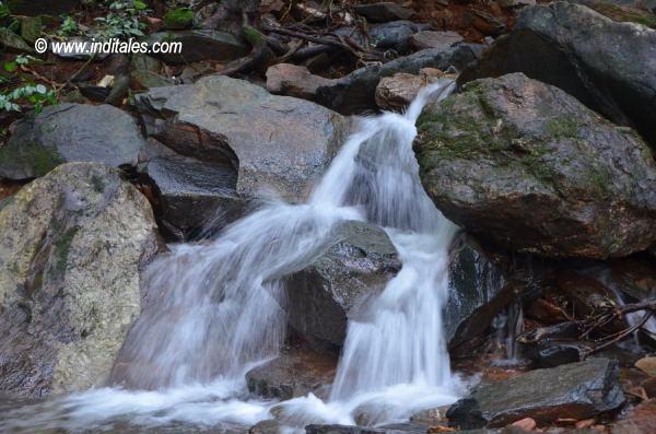 Kuskem Waterfalls streams by the rocks