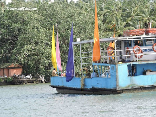 Boats with flags at old goa jettty