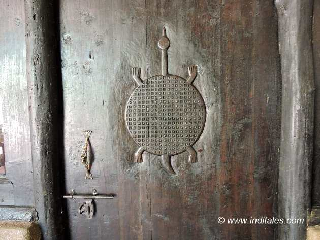 Turtle carved on a wooden door