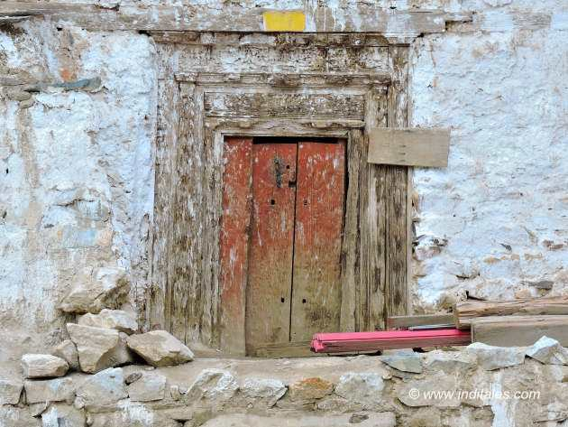 Carved wooden doors in the village