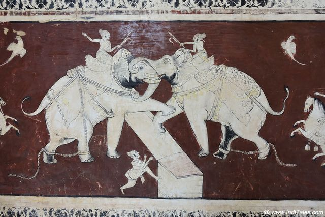 Bottom red and White panel of Elephant's participating in a war