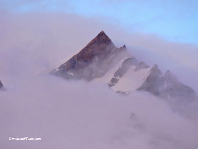 Sharp peaks emerging from the clouds
