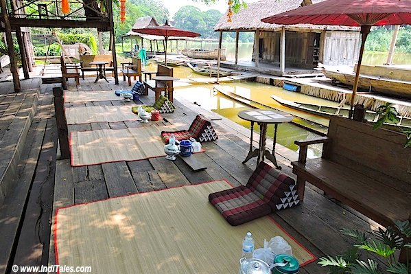 Mats laid out by the riverside to eat food at Tai Yuan Cultural Centre Saraburi