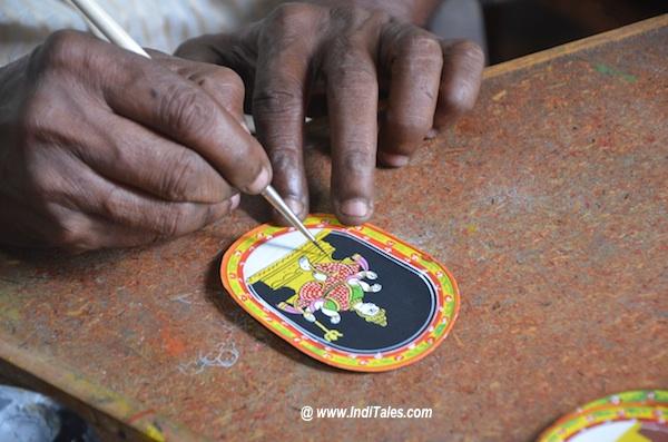 An artisan painting a Tarot Card at Sawantwadi Palace