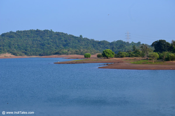 Blue backwaters of Amthane Dam by dusk