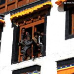 People hanging from windows to watch Cham Dance at Spituk Monastery, Ladakh