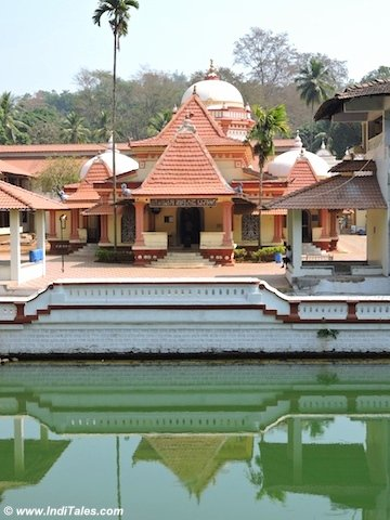 Sh Nagesh Maharudra or Nageshi Temple reflecting in its tank