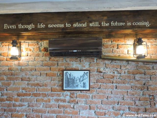 Landour Bakehouse Brick walls with quotes