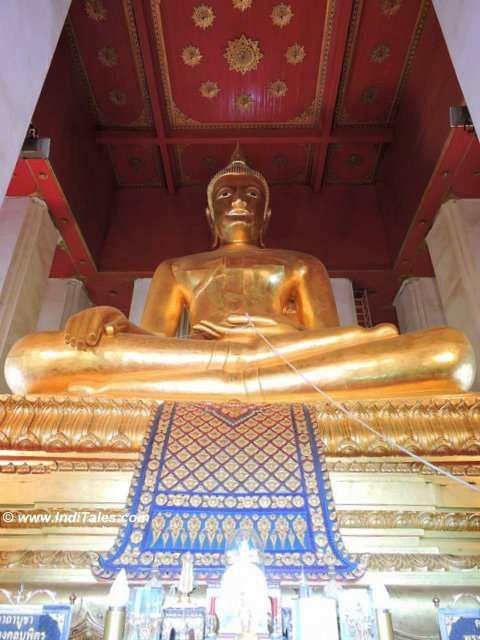 Giant Buddha bronze statue at Wihan Phra Mongkhon Bophit