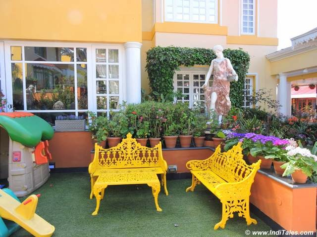 Bright Yellow Garden Benches at Mayfair Darjeeling