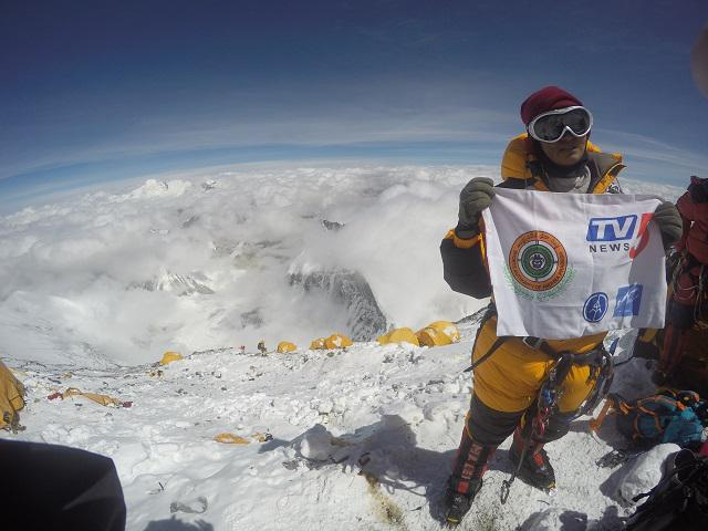 Neelima Pudota with clouds beneath her at Mount Everest or Sagarmatha