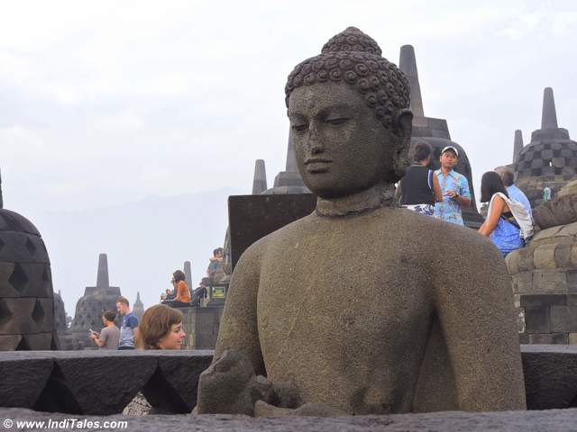 Buddha sits quietly as the world moves around at Borobudur Temple compounds