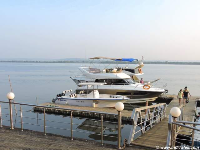 Yachts parks at Britona Jetty on Mandovi