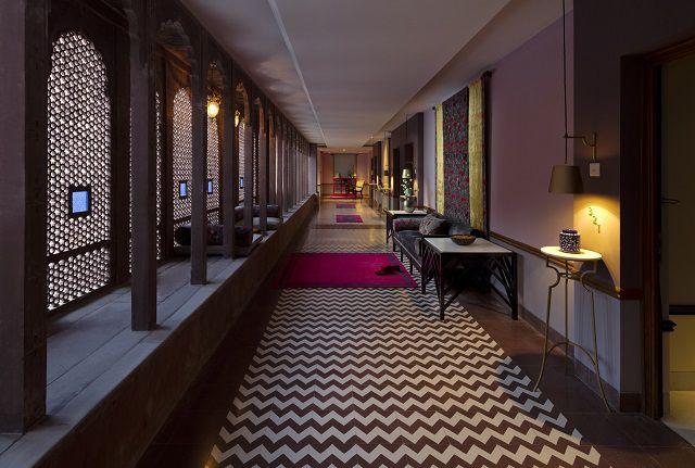 Jharokhas frame the corridors while tiles lit them up