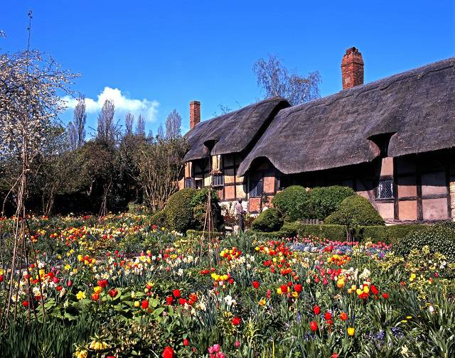 Anne Hathaway's cottage surrounded by flowers - stratford upon avon