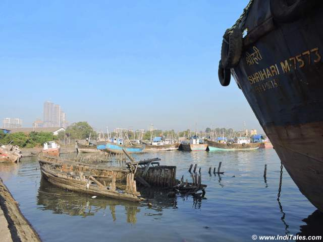 View of the Sewri Jetty with high rise buildings in the background