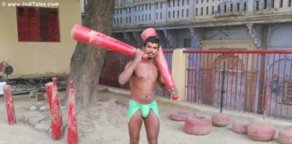 Wrestler exercising with jodi at Tulsi Akhada