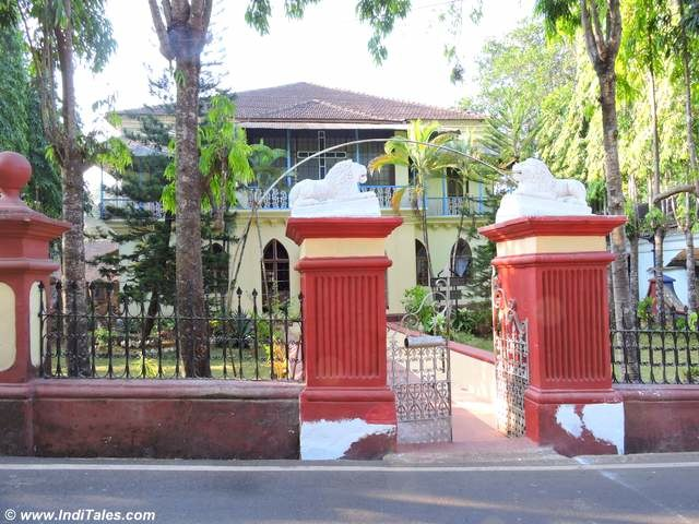 House gates guarded by lions