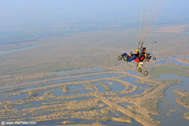 Powered Paraglider hovering over Krishna river