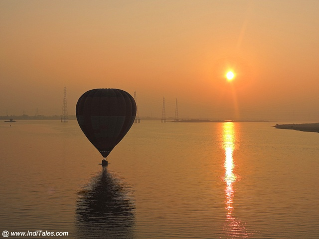 Sunrise scene with a Hot Air Balloon over Krishna river at Amaravati