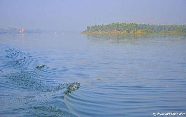 Wave trails of boat ride over Krishna river, Amaravati