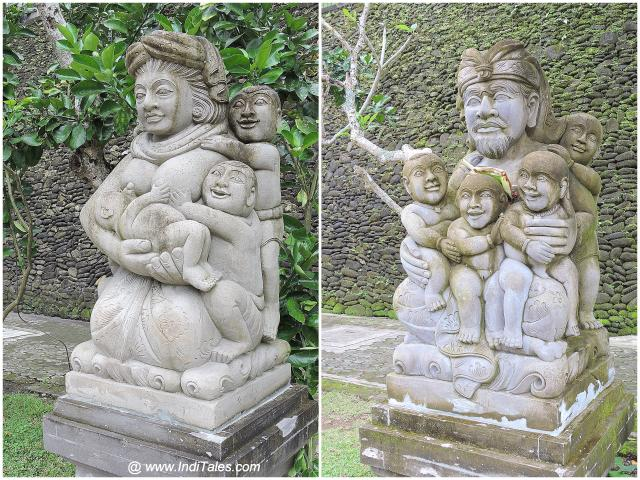 Sculptures outside Tirta Empul Temple - Bali, father with children, mother with children