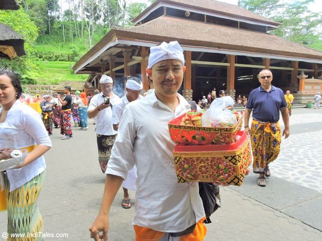 Devotees carrying offerings at Tirta Empul - Bali