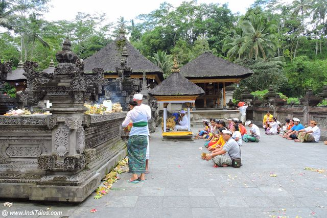 Devotees worshiping at Tirta Empul Temple - Bali, Indonesia