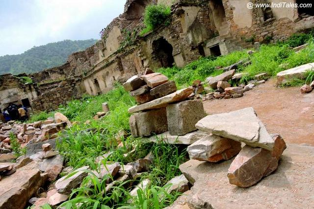 Fallen stones and ruins of the Bhangarh Fort