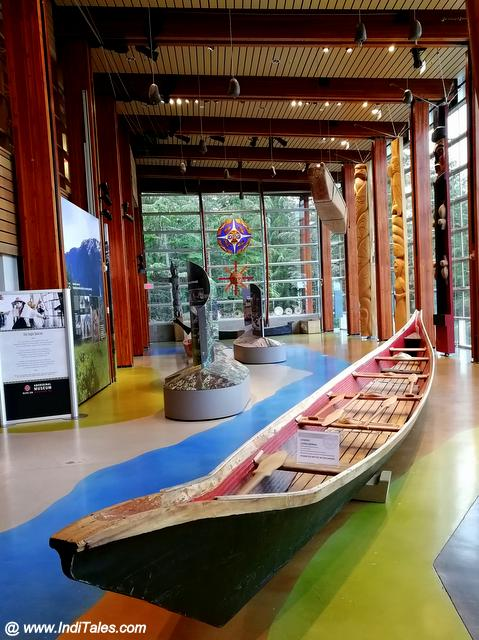 Long narrow canoe carved out of a single log of red cedar wood at Squamish & Lil'wat Centre