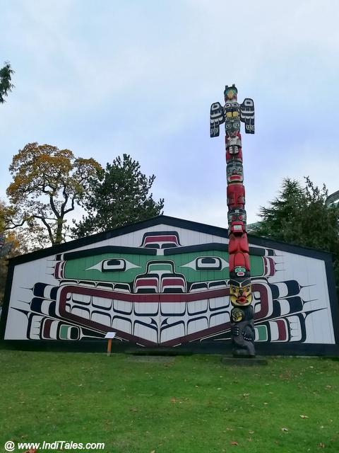 First Nations Art - Totem Poles and painted walls, behind Royal BC Museum