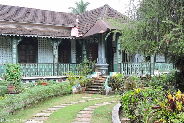 Green House with Filigree Pillars and Brackets - Madgaon