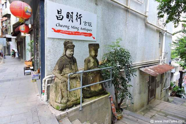 Statues standing on the street corners - Hong Kong Street Art