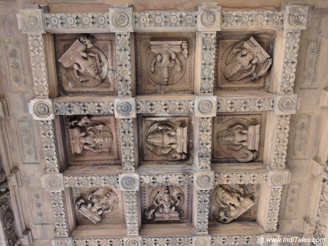 Deities wood carvings on the ceiling at Bhagamandala Temple