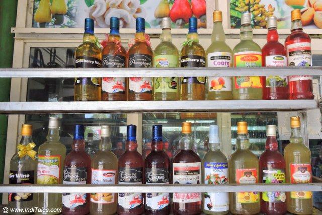 Homemade Wine in a variety of flavors on display, Coorg Souvenirs