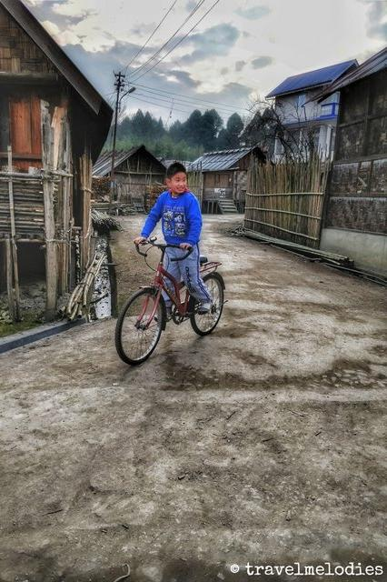 Young Apatani Boy cycling around Haji Basti - Ziro Valley