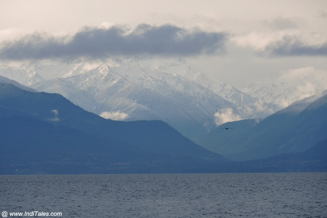 Snow capped mountains seen from Ogden Breakwater
