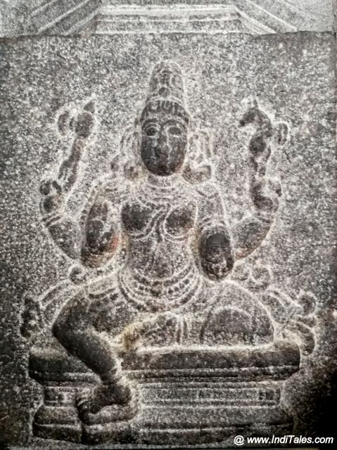 Four armed Devi sculpted on walls of Kamakshi Temple in Kanchipuram
