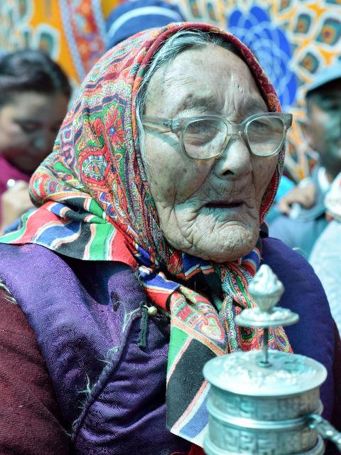 Ladakhi old lady with her prayer wheel...