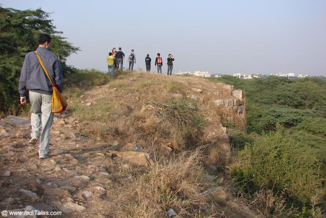 Walking on the fort walls of Lal Kot