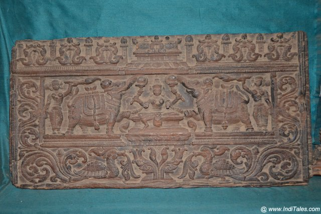 Intricately carved wooden panel at Koyikkal Palace