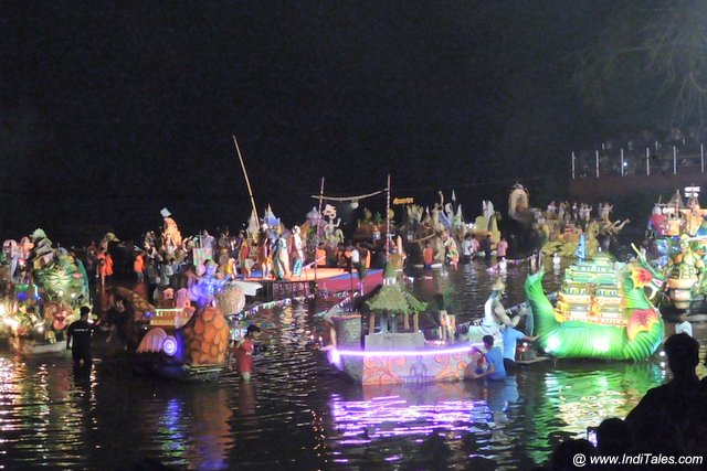 Decorated mini boats lined up in Valvanthi river, Festivals of Goa