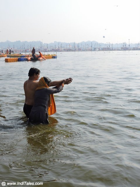 Devotees taking a holy dip at Triveni Sangam