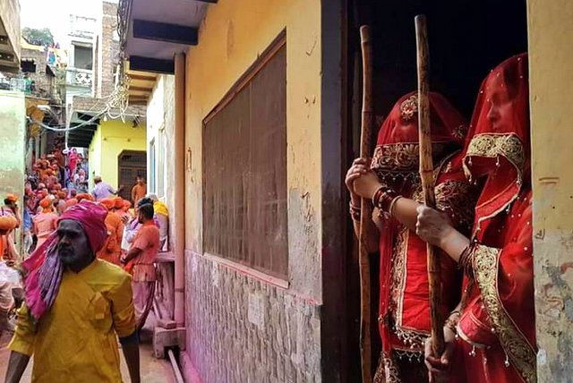 Women with their Lath during Holi
