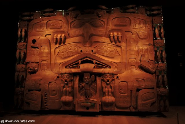 Wooden screen used for theatrical performances by First Nations