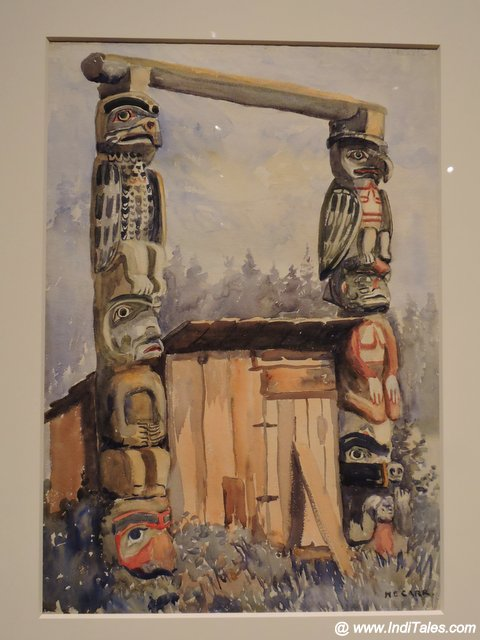 Emily Carr painting showing Totem Poles at Audain Museum