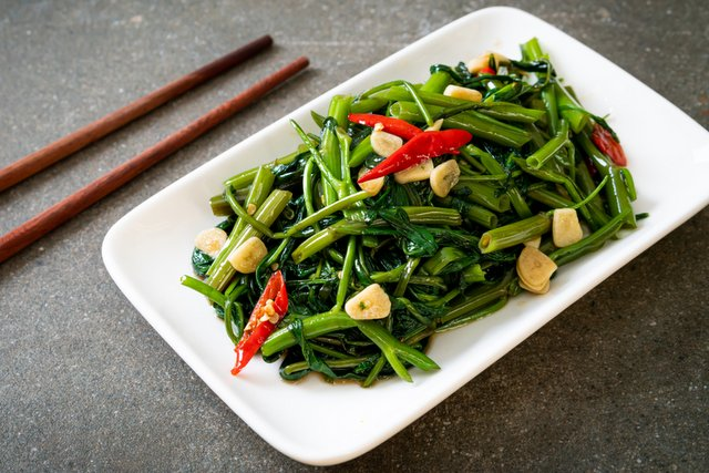 Pak Boong the stir-fried Chinese Morning Glory or Water Spinach. Popular Vegetarian Thai Food