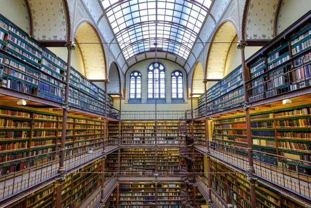 Rijksmuseum library Amsterdam: neo-gothic style, glass roof, arches and galleries of books