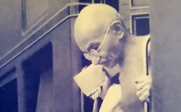 Gandhiji alighting from train
